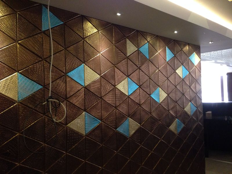 Lapelle leather tiles - detail of composition for reception in a hotel in Baghdad