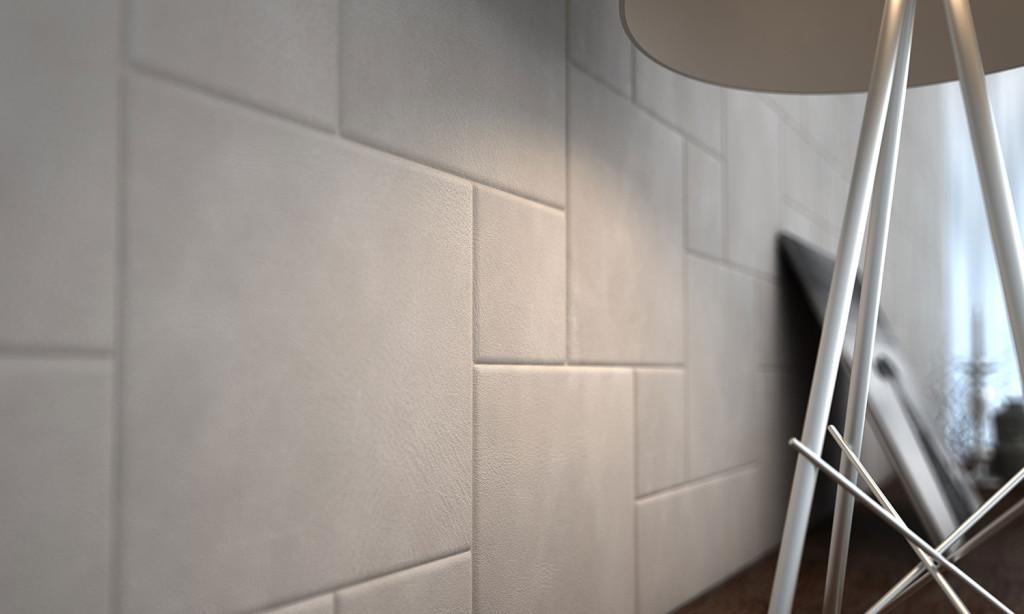 Dettaglio rivestimento in pelle Lapèlle per parete living
