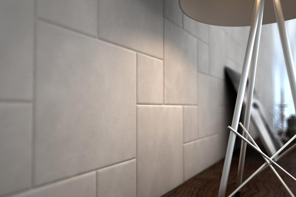Sala living - dettaglio composizione piastrelle in pelle Lapèlle